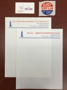 A business card, sticker, and examples of Lam's campaign stationery.
